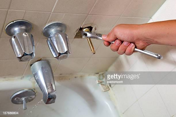 Plumber Works on Bathtub