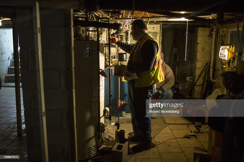 Plumbers install a new boiler in a basement at a private residence January 17, 2013 flooded during Hurricane Sandy in the Rockaways January 17, 2013 in the Queens borough of New York. A $50.7 billion Superstorm Sandy aid package was voted through the House of Representatives recently. The funding would be spent on New York and New Jersey transit systems and for the Federal Emergency Management Agency's disaster relief fund.