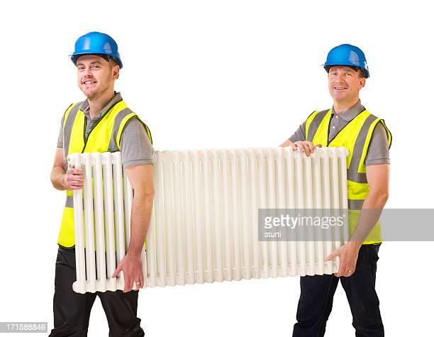plumbers with radiator