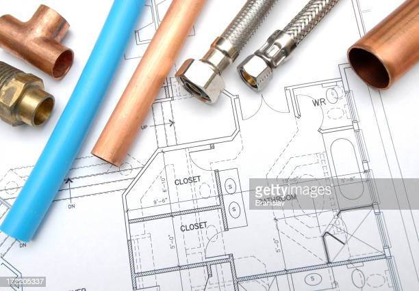 Plumbing pipes and joins on top of house schematic