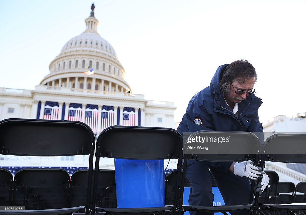 Plumbing Supervisor Ken Feaga of Architect of the Capitol helps to line-up chairs for the presidential inauguration at the West Front of the U.S. Capitol January 20, 2013 in Washington, DC. President Barack Obama will be officially sworn in for his second term today during a short private ceremony at the Blue Room of the White House. A full public ceremony will be held at the West Front of the Capitol on Monday.