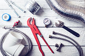 plumbing tools and accessories on wooden table. top view