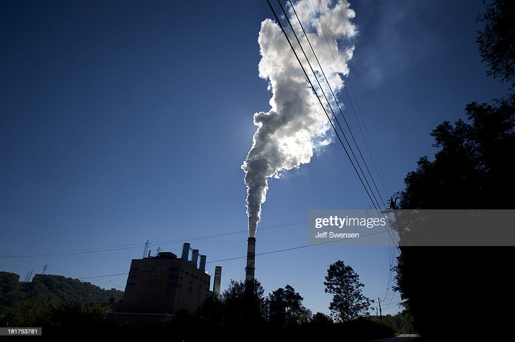 A plume of exhaust extends from the Mitchell Power Station a coalfired power plant located 20 miles southwest of Pittsburgh on September 24 2013 in...