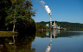 A plume of exhaust extends from the Mitchell Power Station a coalfired power plant built along the Monongahela River 20 miles southwest of Pittsburgh...