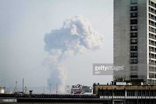A plume of smoke can be seen over Brazzaville from across the Congo River in Kinshasa capital of neighbouring Democratic Republic of Congo on March 4...