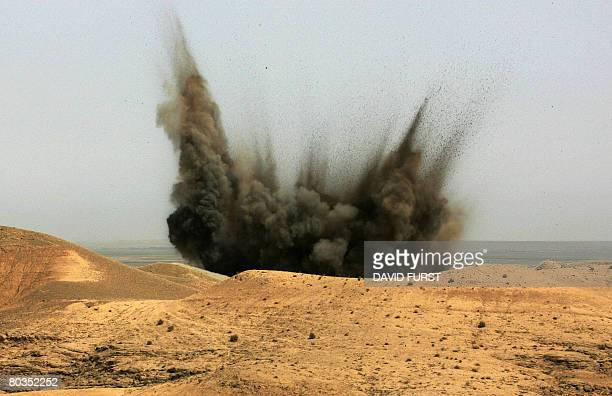 A plume of smoke rises from an airstrike ordered by US soldiers from Ghostrider Company 3rd Squadron 2nd Stryker Cavalry Regiment to destroy a desert...
