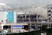 A plume of smoke rises over Brussels airport after the controlled explosion of a third device in Zaventem Bruxelles International Airport after a...