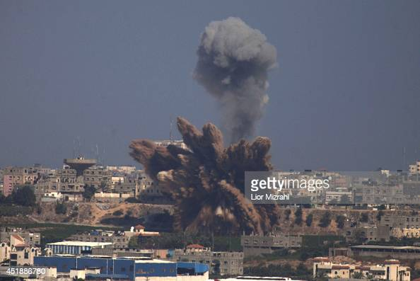 A plume of smoke rises over Gaza following an Israel Air Force bombing as seen from near Sderot on July 9 2014 in Israel Due to recent escalation in...