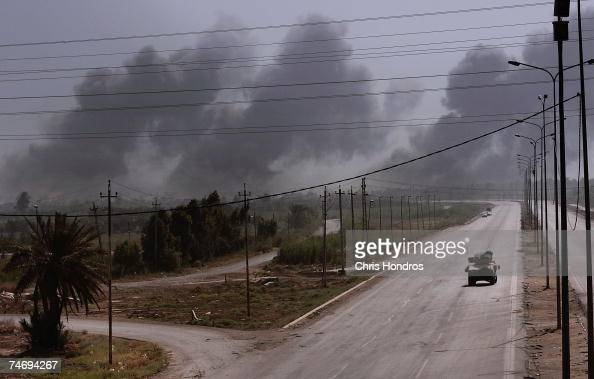 Plumes of smoke rise from bombing runs as the US military uses airstrikes against insurgent targets June 17 2007 in Baghdad Iraq American forces...