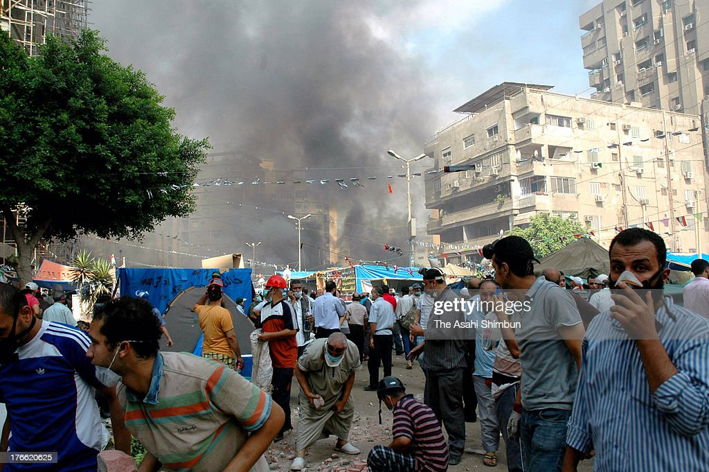 Plumes of smoke rise from the area of a violent crackdown by Egyptian Security Forces on a proMorsi sitin demonstration at the Rabaa alAdweya Mosque...