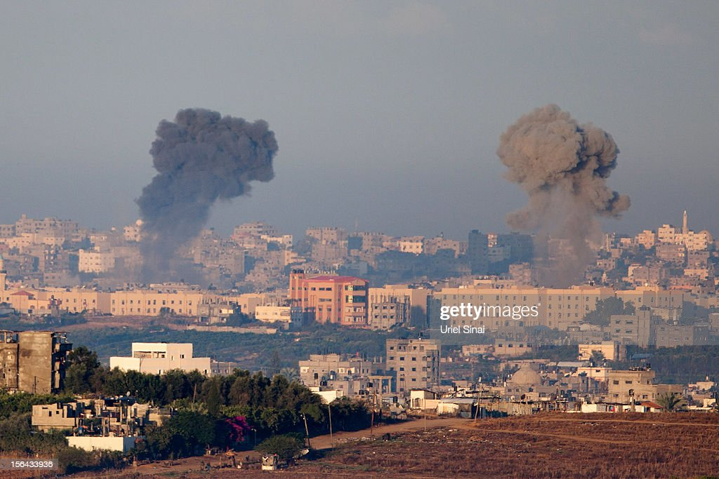 Plumes of smoke rise over Gaza during an Israeli air strike as seen from Sderot on November 15 2012 in Israel A rocket attack on an apartment...