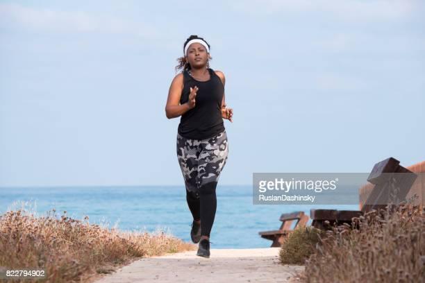 A plump woman on a morning run.