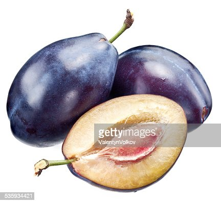 Plums and half of plum. : Stock Photo