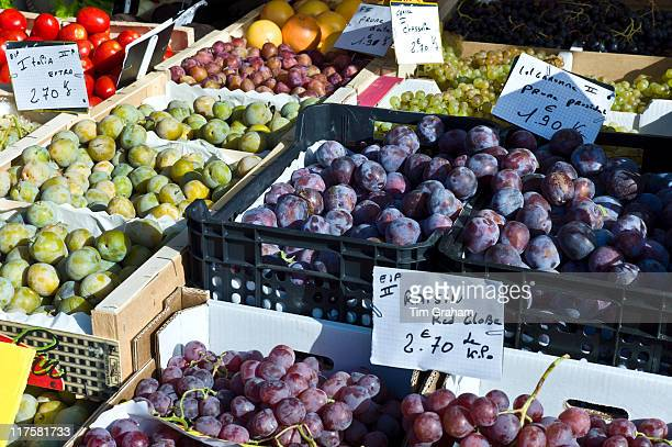 Plums grapes and greengages fresh fruit on sale at food market at La Reole in Bordeaux region of France