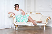 Plus size fashion model, fat woman on luxury interior, overweight female body, full length portrait