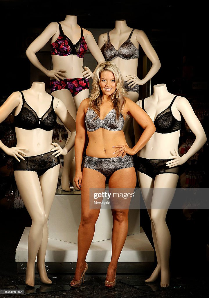 Plus size model Emma Harrison poses with size 16D plus size manniquins at Myer Department store on August 17, 2010 in Melbourne, Australia.