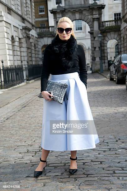 Plus size model Louise O'Reilly wears Coast skirt and scarf Next shoes And Other Stories jumper and a Parfois clutch on day 3 of London Collections...