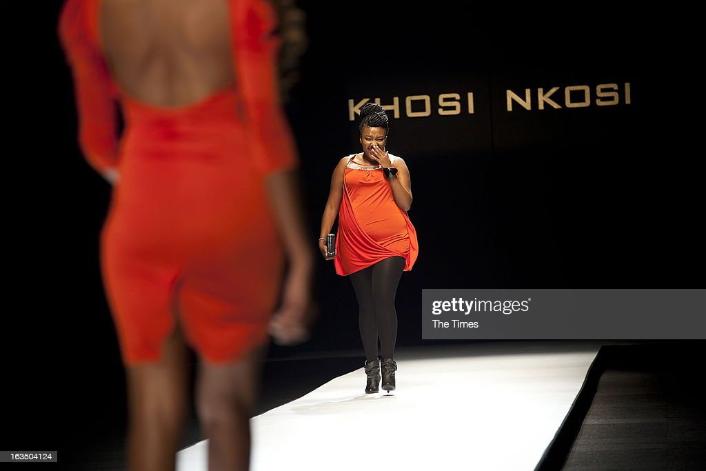 A plus sized model walks down the ramp during the Khosi Nkosi fashion show at the Mercedes-Benz Fashion Week on March 7, 2013 in Newtown, Johannesburg, South Africa. Fashion lovers got to see the fashion trends for Autumn and Winter.