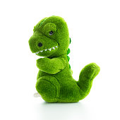 Green angry or filling fighting plush dinosaur doll, isolated on white.