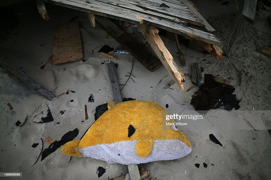 A plush toy lies among debris caused by Superstorm Sandy, on November 24, 2012 in Seaside Heights, New Jersey. New Jersey Gov. Christie estimated that Superstorm Sandy cost New Jersey $29.4 billion in damage and economic losses.