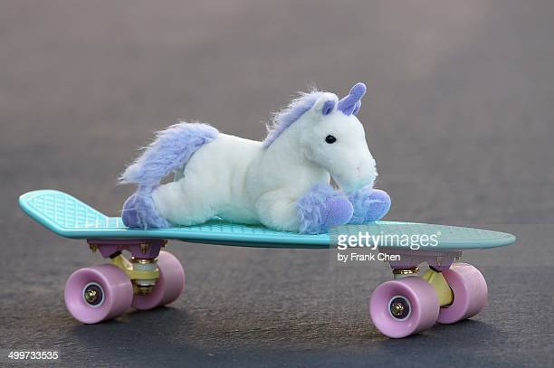 Plush Unicorn Riding An Awesome Skateboard