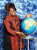 Plus-sized woman displaying globe