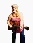 Plus-sized woman in cowboy hat playing guitar