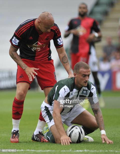 Plymouth Argyle Lewis Alessandra and Swansea City's Jonjo Shelvey during pre season friendly match at Home Park Plymouth