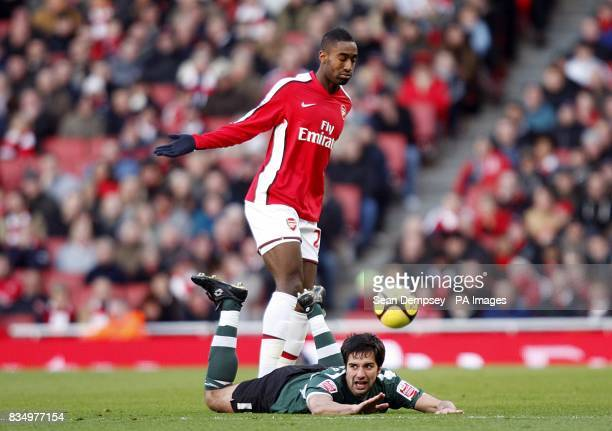 Plymouth Argyle's Rory Fallon is fouled by Arsenal's Johan Djourou as they battle for the ball
