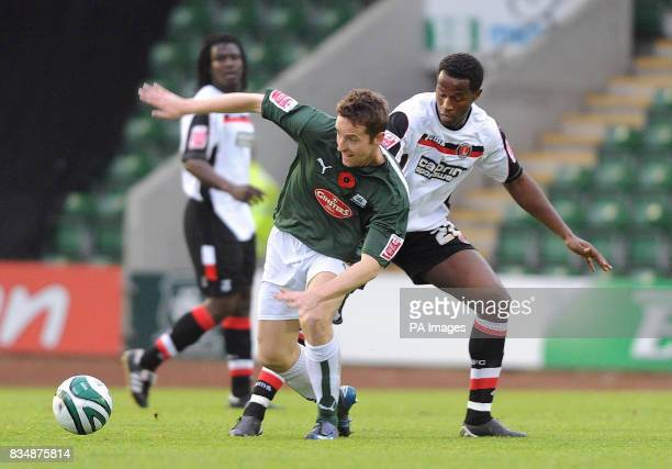 Plymouth Argyle's Steve Maclean is challenged by Charlton's Jose Semedo during the CocaCola Championship match at Home Park Plymouth