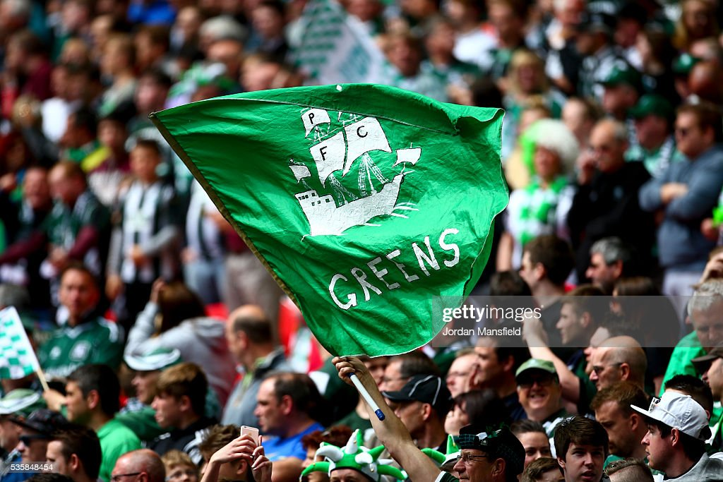 A Plymouth fan waves a flag prior to kick-off in the Sky Bet League Two Play Off Final match between Plymouth Argyle and AFC Wimbledon at Wembley Stadium on May 30, 2016 in London, England.