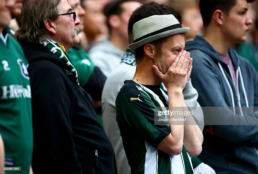 Plymouth fans look dejected after their loss in the Sky Bet League Two Play Off Final match between Plymouth Argyle and AFC Wimbledon at Wembley Stadium on May 30, 2016 in London, England.