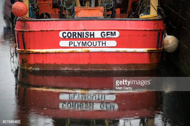 Plymouth registered fishing boat is seen in the harbour as the allfemale eXXpedition crew get ready on board the yacht Sea Dragon nearby as they...