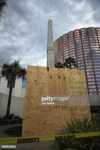 Plywood covers part of a statue that shows two figures of Confederate soldiers in front of the Hillsborough Country Courthouse as the city plans to...