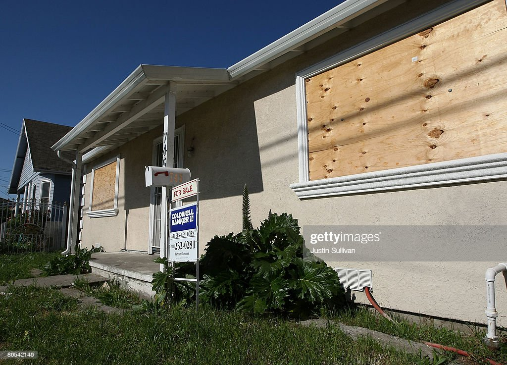 Plywood covers the windows of a foreclosed home for sale May 7, 2009 in Richmond, California. A study of government data on subprime loans by the Center for Public Integrity showed that 56 percent of the $1.38 trillion in subprime mortgages originated from 15 lenders in California between 2005 and 2007.