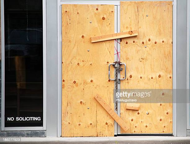 Plywood over doors of closed business