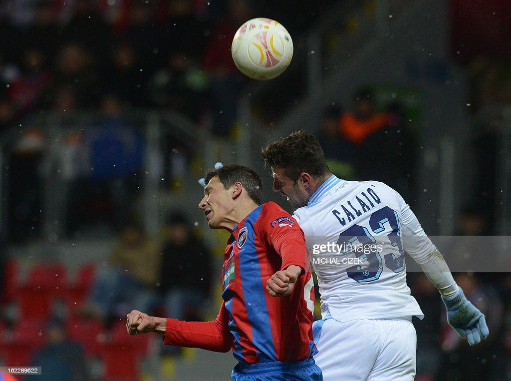 Plzen's defender Marian Cisovsky (L) vies for the ball with Napoli's forward Emanuele Calaio during the UEFA Europa League Round of 32 football match FC Viktoria Plzen vs SSC Napoli in Plzen, Czech Republic on February 21, 2013.