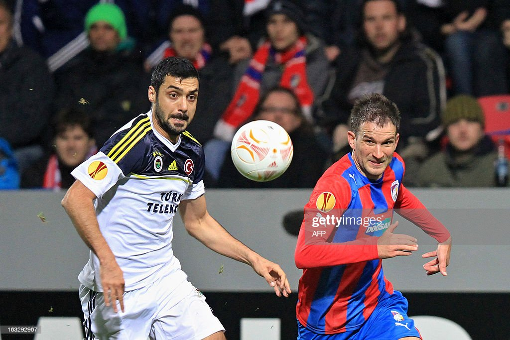 Plzen's Marek Bakos (R) fights for the ball with Fenerbahce's Bekir Irtegun (L) during the UEFA Europa League Round of 16 first leg football match FC Viktoria Plzen vs Fenerbahce SK in Plzen, Czech Republic, on March 7, 2013.