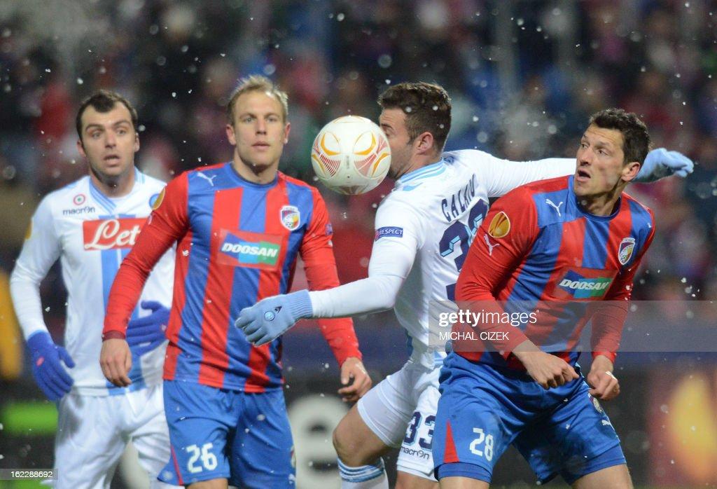 Plzen's midfielder Daniel Kolar (2nd L) vies for the ball with Napoli's forward Emanuele Calaio (2nd R) during the UEFA Europa League Round of 32 football match FC Viktoria Plzen vs SSC Napoli in Plzen, Czech Republic on February 21, 2013.