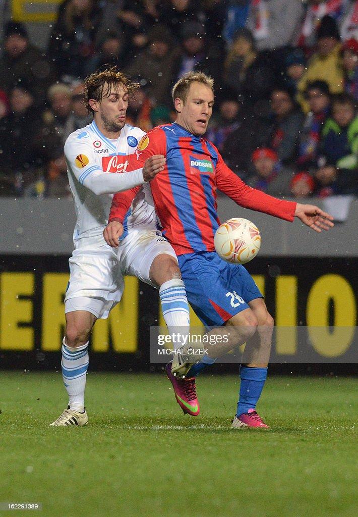 Plzen's midfielder Daniel Kolar (R) vies for the ball with Napoli's midfielder Marco Donadel during the UEFA Europa League Round of 32 football match FC Viktoria Plzen vs SSC Napoli in Plzen, Czech Republic on February 21, 2013.