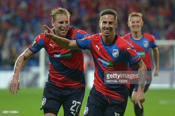 Plzen's Milan Petrzela celebrates with his teammate Frantiek Rajtoral after scoring the 20 during the UEFA Europa League Group E football match...