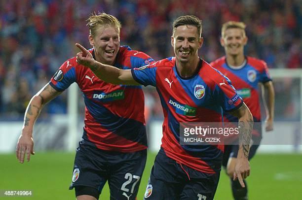 Plzen's Milan Petrzela celebrates with his teammate Frantiek Rajtoral after scoring the 20 during the UEFA Europa League Group E football match...