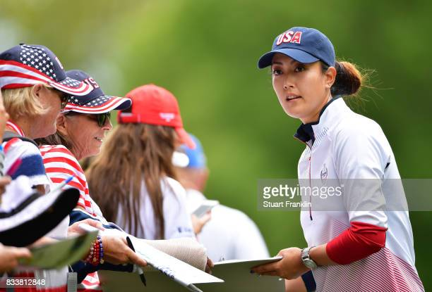 PMichelle Wie of Team USA signs autographs for fans during practice prior to The Solheim Cup at Des Moines Golf and Country Club on August 17 2017 in...