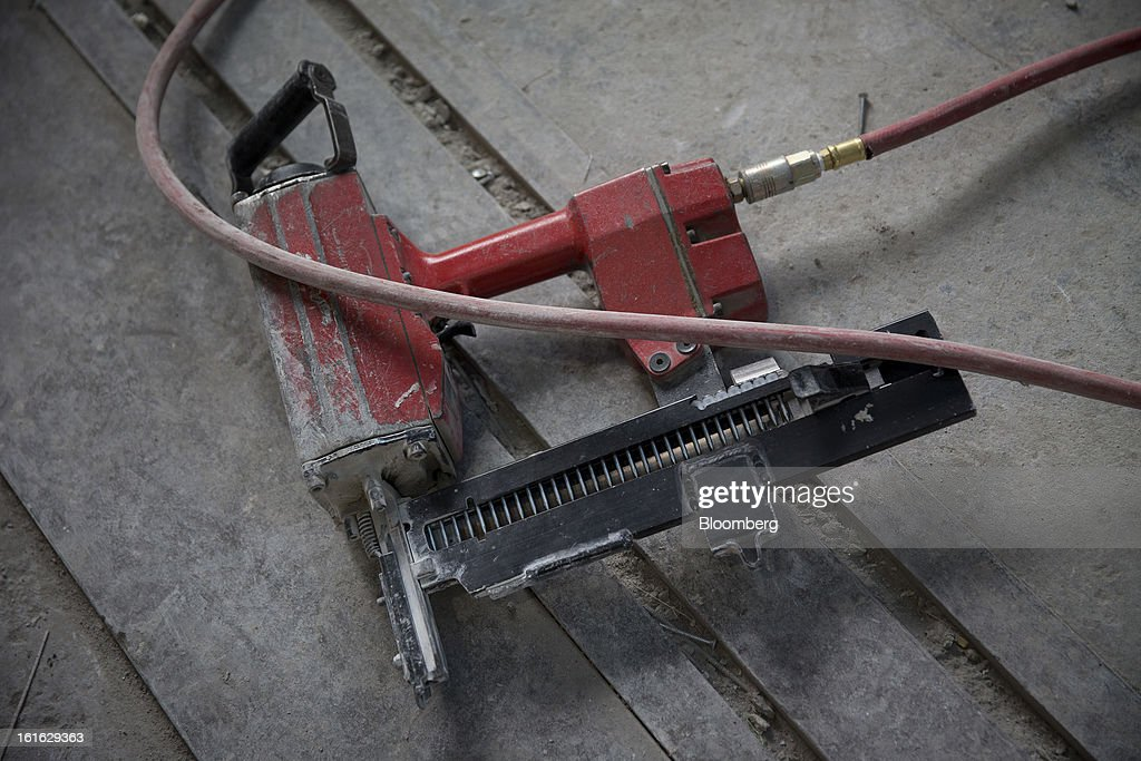 A pneumatic nailer lies on the Capsys Corp. factory floor at the Brooklyn Navy Yard in the Brooklyn borough of New York, U.S., on Wednesday, Feb. 13, 2013. Capsys Corp., which specializes in prefabricated buildings, will be building micro-unit apartments in New York City. Photographer Scott Eells/Bloomberg via Getty Images