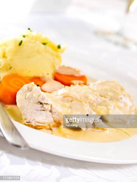 Poached chicken with white wine sauce