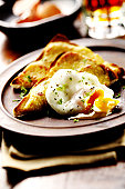 Poached egg on toast with cheese & herbs