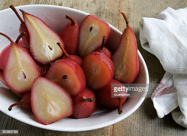 Poached pears in white dish.