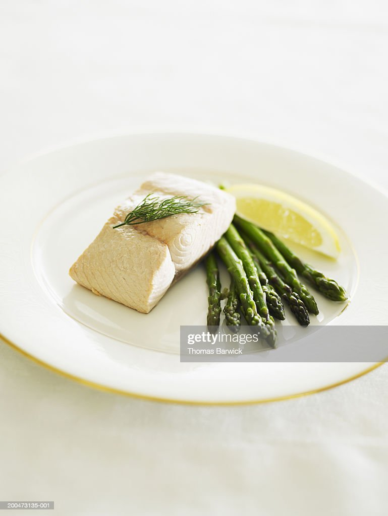 Poached wild Pacific king salmon with asparagus, dill and lemon : Stock Photo