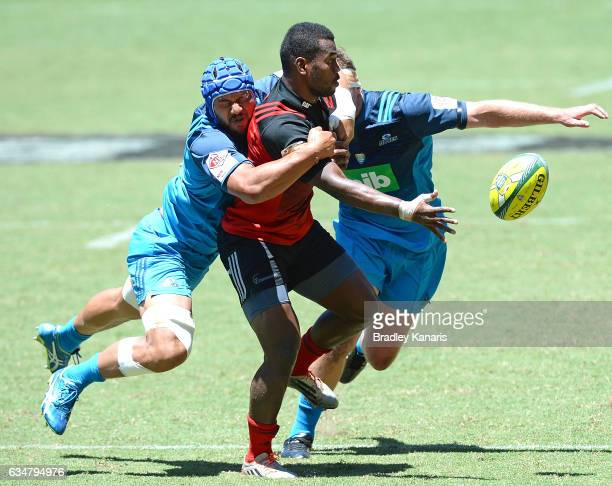 Poasa Waqanibau of the Crusaders gets a ball away during the Rugby Global Tens match between the Crusaders and Blues at Suncorp Stadium on February...