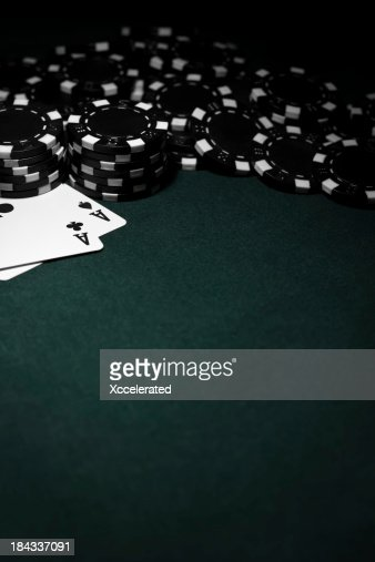 Pocket Aces with Black Poker Chips
